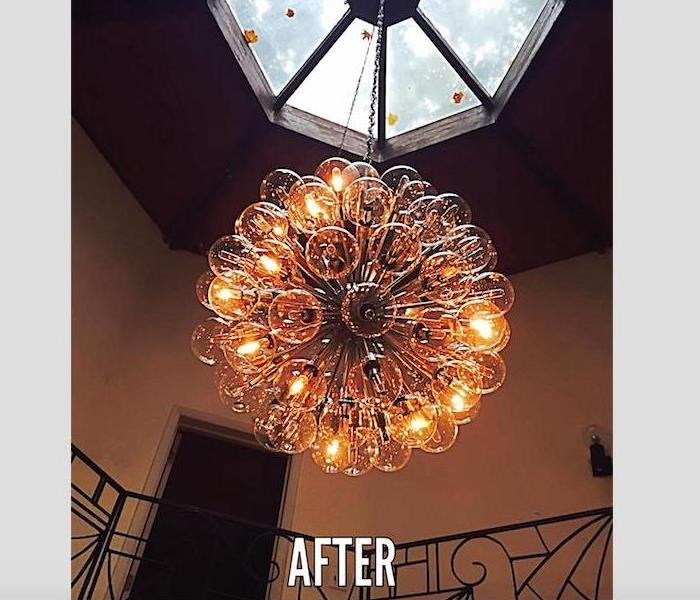 large glass ball chandelier after cleaning