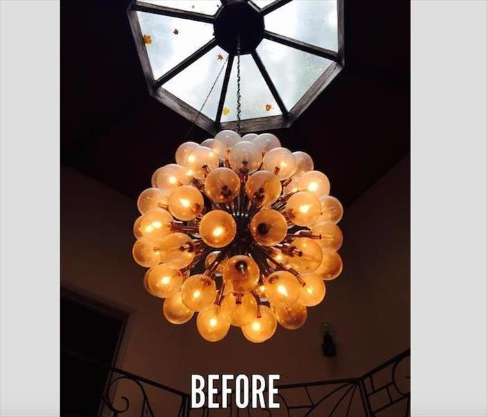 large glass ball chandelier before cleaning