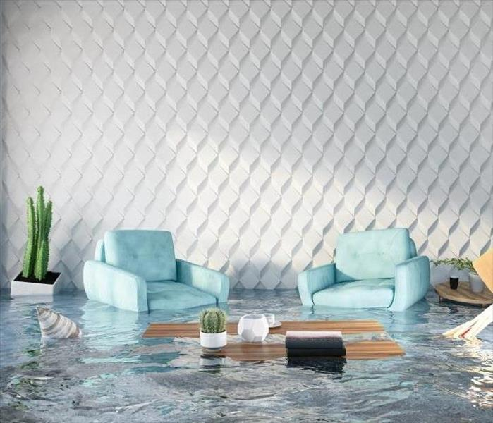 flooded house with two blue armchairs and coffee table